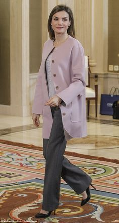 She's not afraid of being seen in the same outfit twice and today Spain's stylish Queen Letizia donned a pretty pink coat she debuted just weeks ago