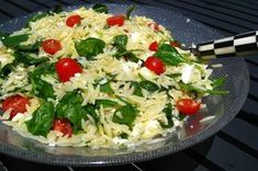 I've been making this recipe for years -- it's one of the most popular dishes at any Picnic or BBQ, I think because of the perfect combination of the sweet tomatoes with the salty cheese and lemony dressing. It also doesn't hurt that it's just so darn pretty and colorful to look at. The best part about the orzo salad is you can make it ahead of time (it gets better as the hours pass) and you can feed an army of picnic-ers. If there happens to be any leftovers, it's wonderful the next day…