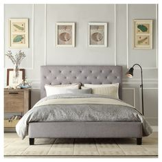 Give your bedroom a romantic update with the Loraine Tufted Bed. Sleek, grey linen upholstery covers the durable hardwood frame, with tufting details on the headboard for a dreamy finish. The neutral upholstery is the perfect base to create a look all your own ; accessorize with bold accents for contemporary look, or add subtle drama with neutral linens. Mattress, pillows, linens, etc. are not included. Box spring required for use.