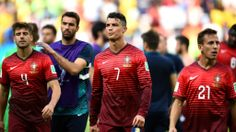 BRASILIA, BRAZIL - JUNE 26: (L-R) Miguel Veloso of Portugal, Cristiano Ronaldo of Portugal and Joao Pereira of Portugal show their dejection after the 2014 FIFA World Cup Brazil Group G match between Portugal and Ghana at Estadio Nacional on June 26, 2014 in Brasilia, Brazil. (Photo by Dennis Grombkowski - FIFA/FIFA via Getty Images)  2014 FIFA World Cup Brazil™: Portugal-Ghana - Photos - FIFA.com