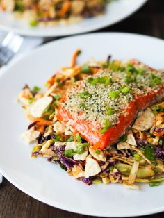Spicy Peanut Slaw With Hemp Crusted Salmon! Serve slow roasted salmon crusted with hemp hearts over a crunchy slaw of cabbage and crushed brown rice crackers in a spicy peanut sauce! A super satisfying main dish salad! Delicious Dinner Recipes, Good Healthy Recipes, Quick Recipes, Free Recipes, Yummy Recipes, Salad Recipes, Seafood Dishes, Seafood Recipes, Recipes