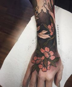 Oriental japanese cherry blossoms colour hand tattoo by Akos Tattoo