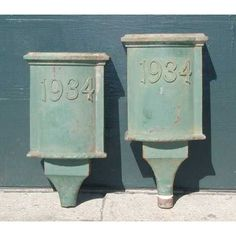 Two English Painted Iron Rain Scuppers      Ref: M1713  $1,850.00  With old green paint and the date 1934 detailed on the front. They would have originally adorned a tudor style home in Exeter, England.  Dated 1934  W 17 D 10 H 34/3 in.7