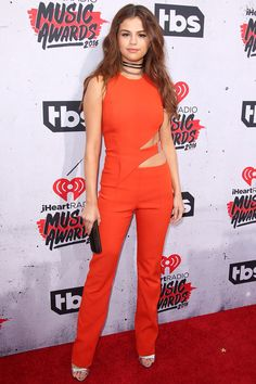 Not one to be outdone, Selena Gomez rocks a fiery Mugler jumpsuit for the 2016 iHeartRadio Music Awards.