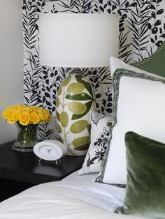 "Sarah's House: A Mid-Century Home Gets a Stylish Makeover : On_tv : HGTV ""Low-cost yet high-impact elements helped Sarah create an eye-catching guest room on a tight budget. A wall of bold, black-and-white wallpaper creates a striking backdrop for the bed and gives the room an instant wow factor."" I LOVE THIS LAMP WITH THE GREEN VELVET PILLOW. GREEN BLACK AND WHITE IS SHARP!"