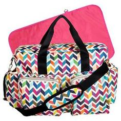 Form meets ultimate function and space with the French Bull Ziggy Multi-Colored Chevron Deluxe Duffle Diaper Bag. <br>Deluxe Duffle Diaper Bags, manufactured by Trend Lab, are spacious enough for parents with multiple<br>children and feature sophisticated style, several organizational pockets, a durable wipe-off exterior and <br>extreme versatility. This Deluxe Duffle exterior is made from durable polyester which features French Bull's Signature Ziggy multi-colored...