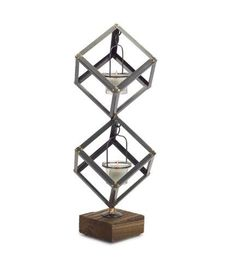 Grant your room a familiar flicker by adding a candle to this modern holder boasting a combination of metal, glass and wood. An balanced cube design throws intricate shadows and light. Industrial Tabletop, Industrial Style, Tall Candle Holders, Cube Design, Wood Glass, Votive Candles, Tea Light Holder, Tea Lights, 3 D