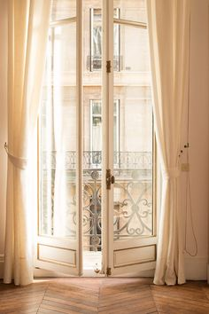 The afternoon light floods the apartment with a warm golden hue in the most magical way. Orientation: PORTRAIT To view more of my Paris - beautiful French doors
