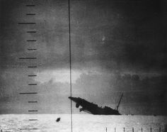 A Japanese destroyer, seen through its attackers periscope,...