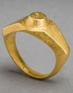 Jewelry Auction - Nov 30th 2016 - Imperial Roman massive solid gold wide-shouldered style ring. A massive Imperial Roman solid gold ring of angular wide shouldered style, a raised circular boss on the bezel. Intact, 3d - 4th Centuries AD, eastern Mediterranean. Ring size is approximate, since ancient rings are not perfectly round. Estimate: $10,000 - $12,000. This and more important ancient art for sale on CuratorsEye.com