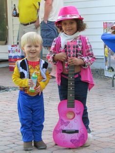 Toy Story, Woody & Jessie. Let the kids dress up! They love it and the pics r so much cuter.