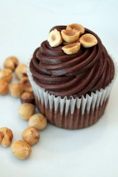 Chocolate Hazelnut Cupcakes with Chocolate Ganache Frosting:     1 cup heavy cream, 12 ounces chocolate, chopped into small pieces – Place chocolate pieces in a large bowl. Heat heavy cream on medium high until it comes to a boil. Remove from heat and immediately pour cream over chocolate and stir until completely mixed and glossy. Cool to thicken before whipping.