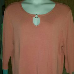 Plus size women's top in peach Medium weight pullover top with elegant detailed neckline and three quarter sleeves, acrylic nylon blend. Warm peach color looks good on almost everybody. Not too heavy and not too light, this top is perfect for spring weather. Tried on but never worn. Evie Tops Blouses