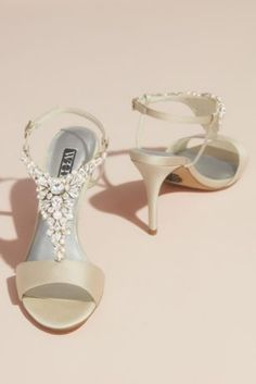 These high-heeled satin sandals truly dazzle thanks to the ornately decorated T-strap vamp adorned with artfully placed clusters of pearls and solitaire, teardrop, and marquise crystals. White by Ver Bling Sandals, White By Vera Wang, Crystal Shoes, Types Of Dresses, White Wedding Dresses, Here Comes The Bride, Davids Bridal, T Strap, Bridal Accessories