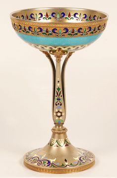 A Russian silver gilt, guilloche, plique-a-jour, and champleve enamel sherbet cup, 1908-1917.