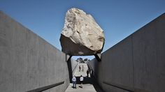Levitated Mass by artist Michael Heizer, considered one of the last great 'land artists', is composed of a 456-foot-long slot constructed on LACMA's campus, over which is placed a 340-ton granite megalith. At 340 tons, the boulder is one of the largest megaliths moved since ancient times.