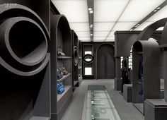 Gray Area: Viktor & Rolf's Paris Flagship by Architecture & Associés | A custom display case combines glass and steel with felt-covered MDF. #design #interiordesign #interiordesignmagazine #retail #decor #fashion