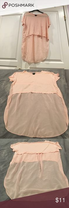 Hi-low partly sheer cropped top It's a nice loose fitting crop top with a mostly sheer back. It is washable and it looks like an orange-y pink color (leaning towards a lighter pick shade) Wet Seal Tops Crop Tops