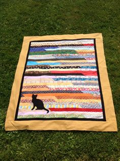 """craftingadventureswithme: """" Here is my jelly roll quilt that I made a few weeks ago at my scrap therapy class! I added a black border to make the cat stand out and to sum everything up then I added a. Jellyroll Quilts, Scrappy Quilts, Amish Quilts, Cute Quilts, Baby Quilts, Colchas Quilt, Quilt Blocks, Cat Quilt Patterns, Block Patterns"""