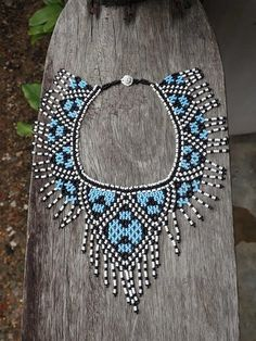 Brazilian Traditional Fulni-o Indigenous Bead Necklace A Stunning Necklace representing Peace and Magic. Made Traditionally with Blue, Black & White Beads The Necklace is in length and wide. Made in Brazil Beaded Jewelry Patterns, Beading Patterns, Paper Beads, White Beads, Beading Tutorials, Bead Weaving, Beautiful Necklaces, Etsy, Handmade Jewelry