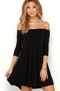 Change up your dress routine with a number that's sure to cause a bit of excitement: the Rock the Bateau Black Off-the-Shoulder Dress! Lightweight black jersey knit falls from an elasticized off-the-shoulder neckline, to fitted three-quarter sleeves, and a relaxed swing bodice. Unlined. 95% Rayon, 5% Spandex. Machine Wash Cold. Made with Love in the U.S.A.