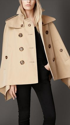 DESCRIPTIONCreated to celebrate the launch of My Burberry, the new fragrance for women. A cotton gabardine trench cape with oversize buttons. Invented by Thomas Burberry in cotto. Trent Coat, Burberry Coat, Burberry Women, High Fashion Outfits, Capes For Women, Cape Coat, Winter Coats Women, Mantel, Feminine Fashion