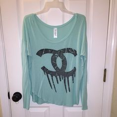 Cute mint green top. Long sleeve Double C dripping design. Very soft and light weight cotton. Fits large like an off shoulder top. Tops