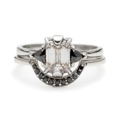 """Brides.com: Emerald-Cut Engagement Rings for Glam, Boho, and Classic Brides. """"Champagne Bea"""" Bridal Set, 1.2 ct champagne colored emerald-cut diamond set in 14kt white gold with black diamond trillions, shown here with the Crescent band in 14kt white gold and black diamonds, $8,400, Anna Sheffield See more white gold engagement rings."""