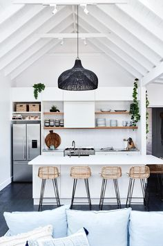 Stunning Kitchen, st-barts.com.au pendant, hkliving.com.au stools, cathedral ceiling | via hometolove.com.au #kitchen #pendantlight #lighting #cathedralceiling #woodandwhite #neutral #rattan #cane