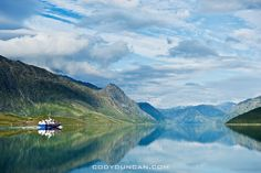 Ferry and mountain reflections on lake Gjende from Gjendesheim From: http://www.codyduncan.com/2011/04/hiking-the-besseggen-ridge-jotunheimen-national-park-norway/