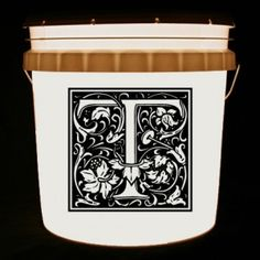 This bucket light features your family initial.
