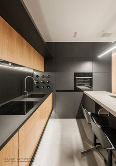 Kitchen Interior Design Compact Krakow Apartment by Hi-Light Architects - InteriorZine - This ultra-modern but cozy apartment designed by Hi-Light Architects is located in Krakow, Poland. The designer Yevhen Zahorodnii searched for a modern