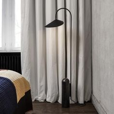 Arum is a floor lamp from Ferm Living with a foot in black marble and a metal lamp shade that gives a trendy and modern look to your home. Black Floor Lamp, Modern Floor Lamps, Captain Flint, Metal Arch, Style Retro, Suites, Vintage Design, Black Marble, Lighting Design