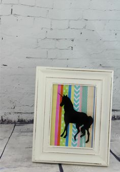 I'm going to show you how to make your own DIY Washi Tape Unicorn Silhouette. Click now!