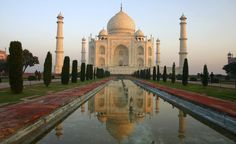 The Taj Mahal is a white marble mausoleum located in Agra, India. It was built by Mughal emperor Shah Jahan in memory of his third wife, Mumtaz Mahal. The Taj Mahal is widely recognized as Taj Mahal India, Le Taj Mahal, Best Honeymoon Destinations, Dream Vacations, Travel Destinations, Travel Tips, Top Vacations, Travel Tourism, Travel Agency
