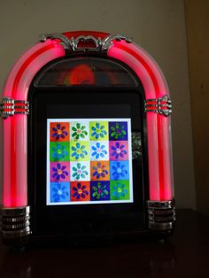 ION Jukebox lit up    http://www.theimum.com/2013/04/jukebox-dock-by-ion-audio-review-and-giveaway/#comment-21992