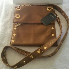 """NWT Hammitt Little Santa Monica Handbag Crossbody New with tags Hammitt crossbody is the perfect small crossbody (dimensions - 9""""Lx1.5""""Wx10""""H).  The bag has a slight bronze/gold tone to it which gives it a little pop. I have the Montana bag in the exact color and its a great light colored bag. It's excellent quality leather in new condition. COMES WITH A DUST BAG AND HAMMITT GIFT BOX! It's beautiful and I get so many compliments in the street on my Hammitt bags its amazing! Hammitt  Bags…"""