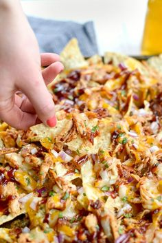 Inspired by one of my favorite pizzas, these Sheet Pan BBQ Chicken Nachos are unbelievably delicious! Tortilla chips are topped with cooked dark and light chicken (that& tossed in my goto homemade sweet barbecue sauce), cheddar and Monterrey Jack ch Bbq Nachos, Bbq Chicken Nachos, Pulled Pork Nachos, Shredded Chicken Nachos, Quesadillas, Bbq Seasoning, Rotisserie Chicken, Tasty Dishes, Mexican Food Recipes