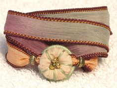 Silk Whirly Wrap Bracelet with peach sari silk delicate fading rose hues.  Easy magnet