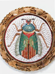 Ever the rage during the 1800s, this Italian micro mosaic of a scarab beetle sends echoes from the time of pharaohs and pyramids. Fascinated by all things Egyptian and exotic, the Victorians often held soirees to unveil, well actually unwrap, the most recently acquired mummy. It was certainly no stretch of the imagination for jewelers of the times to incorporate motifs from ancient periods, such as this example of an Egyptian archaeological revival brooch. ca 1860-70