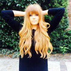 Long strawberry blonde/ red wavy hair with blunt bangs