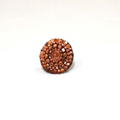Copper Gilded Sphere Ring, $16. Make a statement with this fair trade ring! Handmade by artists in India, this ring is sure to stand out and is the perfect accessory to any outfit.