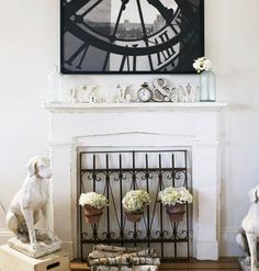 Don't know why anyone would cover a fireplace? I do like the grate with flowers. Would be really fun outside!