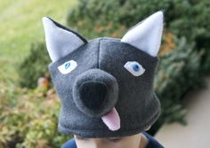 I have a ton of leftover felt from a playhouse I made for the boys...this wolf hat is calling my name!