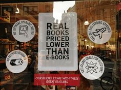 """* Avi Solomon snapped this pic of the window display at NYC bookstore The Strand lauding the virtues of their """"Real books priced lower than ebooks,"""" including the fact that you can read them during take-off and landing *"""