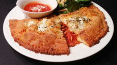 This flexible low carb recipe makes a great keto-friendly crust for calzones and hot pockets.