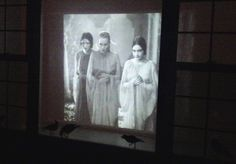 Dracula movie projected on the window.