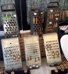 Cute (though somewhat bulky) way to display earrings ... on an antique cheese grater! #diy #organization #jewelry #JewelryDisplays