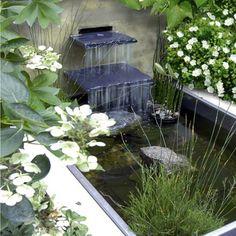 Modern, minimalist waterfall and square pond