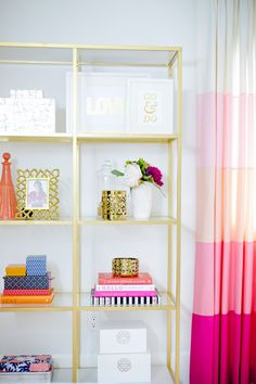 Gold shelves & pink colorblock curtains